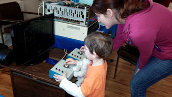 Dual Dazzlers Child playing Altair 8800b running computer tank game